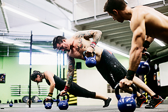 Young muscular man practicing crossfit.
